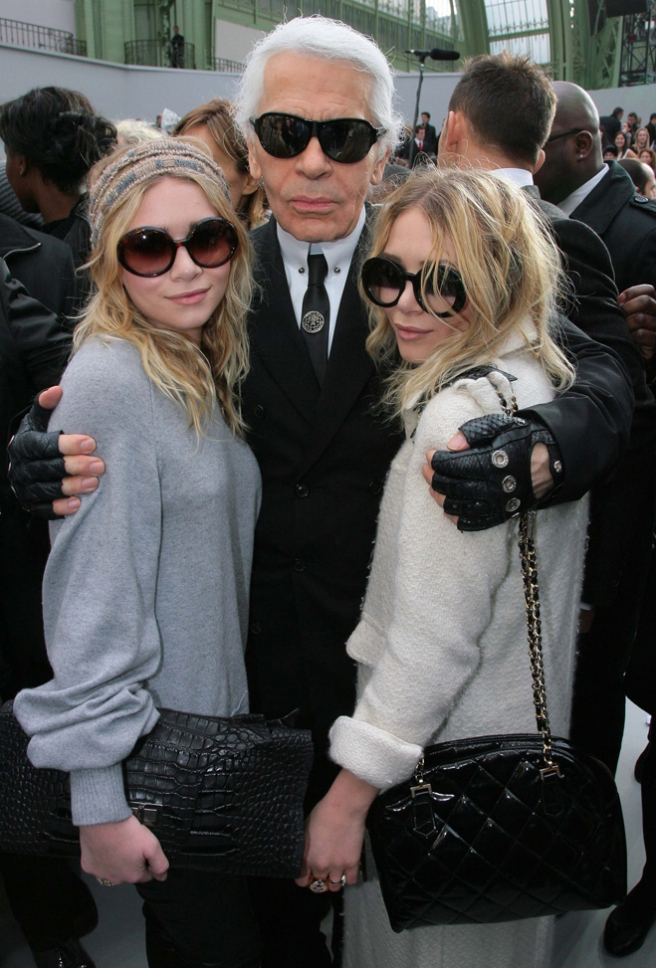 PARIS- FEBRUARY 29:  Ashley Olsen and sister Mary Kate Olsen pose with designer Karl Lagerfeld at the Chanel Fashion show, during Paris Fashion Week (Ready to Wear) Fall-Winter 2008-2009 at the Grand Palais on February 29th, 2008 in Paris, France. (Photo by Eric Ryan/Getty Images) *** Local Caption *** Karl Lagerfeld;Mary Kate Olsen;Ashley Olsen