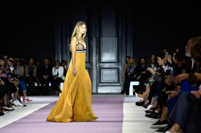Gigi Hadid closes the show in a stunning yellow dress whose shows off her curves. Keep killing it girl!